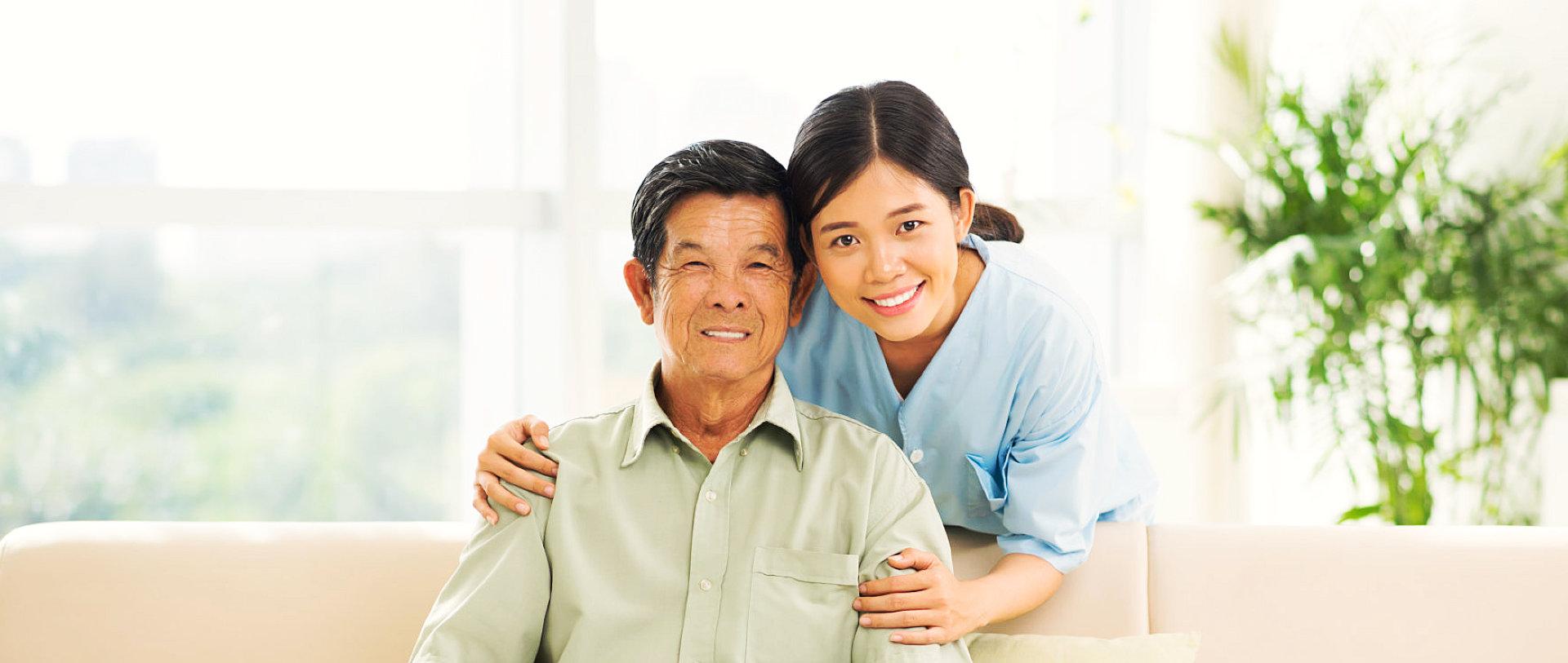 female nurse and senior man smiling